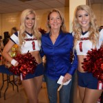 Patricia posing with The Texan Cheerleaders